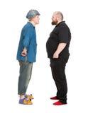 Schauspieler Dressed als Märchen-Held, der mit Fatman spricht Stockfotografie