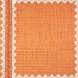 Scheda arancione con i fiori ed i merletti bianchi Fotografia Stock Libera da Diritti