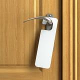 Scheda bianca con lo spazio della copia sul doorknob Immagine Stock