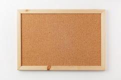 Scheda in bianco del sughero con il blocco per grafici di legno Immagini Stock