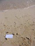 Scheda in bianco in una sabbia Fotografia Stock Libera da Diritti