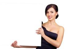 Scheda della holding della donna elegante, isolata Fotografia Stock Libera da Diritti