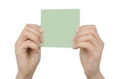Scheda di carta in mani della donna Immagine Stock Libera da Diritti