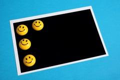 Scheda nera della foto con gli smiley Fotografia Stock