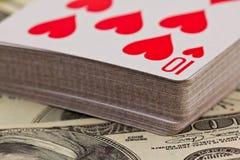 Schede di gioco sui soldi Fotografia Stock
