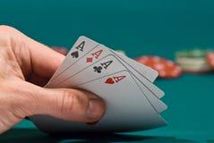 Schede di gioco in una mano Fotografia Stock Libera da Diritti