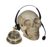 Schedel met Audiomicrofoon en de Dienstklok Royalty-vrije Stock Afbeeldingen