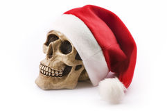 Schedel met rode Kerstmishoed stock afbeelding