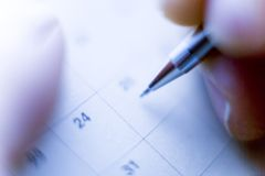 Schedule. BUSINESS IMAGE-close-up shot of hands writing his schedule royalty free stock photos
