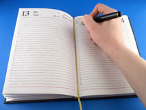 Schedule. Hand, pen, notebook Royalty Free Stock Images