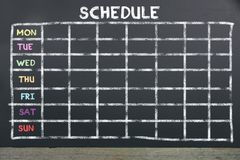 Schedule on board for planning. Schedule with chalk on blackboard for planning. Plan for team work royalty free stock photo