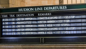 Schedule board. A schedule board in a train station with information telling the time and destinations for travelers Stock Photos