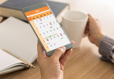 Schedule on the calendar as reminders. The mark on your smart phone schedule on the calendar as reminders of important dates or to schedule a meeting or event stock photography