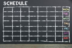 Schedule on chalkboard for planning. Schedule on black chalkboard for planning in everyday. Background for business concept stock photos