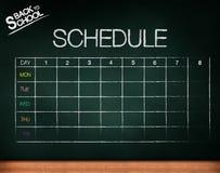 Schedule on chalkboard Stock Image