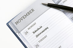 Schedule Colonoscopy. Appointment book with schedule colonoscopy reminder stock photos