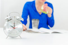 Schedule of the day. Morning. Woman having breakfast royalty free stock images