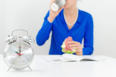 Schedule of the day. Morning. Woman having breakfast royalty free stock photography
