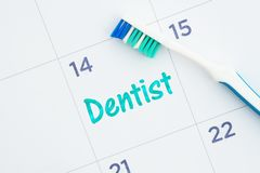 Schedule a dentist appointment message on a calendar with a toothbrush stock photography