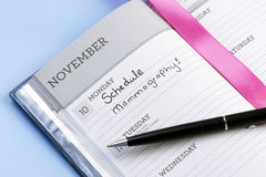 Schedule Mammography. Appoinment book with schedule mammography reminder Royalty Free Stock Photography