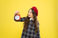 Schedule and timing. Girl with alarm clock. Set up alarm clock. Child little girl hold red clock. It is time. Always on. Time. It is never too late. Define your stock images