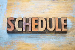 Schedule word in wood type. Schedule - word abstract in vintage letterpress wood type royalty free stock photos