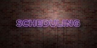 SCHEDULING - fluorescent Neon tube Sign on brickwork - Front view - 3D rendered royalty free stock picture. Can be used for online banner ads and direct Stock Images