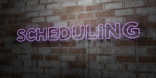 SCHEDULING - Glowing Neon Sign on stonework wall - 3D rendered royalty free stock illustration. Can be used for online banner ads and direct mailers Stock Photos