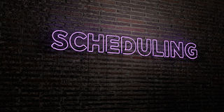 SCHEDULING -Realistic Neon Sign on Brick Wall background - 3D rendered royalty free stock image. Can be used for online banner ads and direct mailers Royalty Free Stock Photography