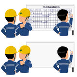 Scheduling. Three workers is scheduling his their work on  the white board Stock Image