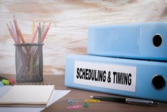 Scheduling and Timing, Business Concept. Office Binder on Wooden Desk royalty free stock photos