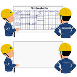 Scheduling. Two workers is discussing about work schedule Stock Image