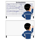 Scheduling. Worker is scheduling his work on the white board Stock Image