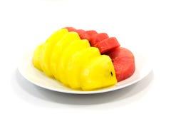 Scheibe der roten und gelben Wassermelone Lizenzfreie Stockfotos