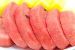 Scheibe der roten und gelben Wassermelone Stockfotografie