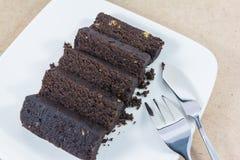 Scheibe des dunklen Schokoladenkuchens Lizenzfreies Stockfoto