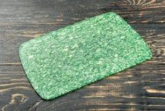 Scheibe des grünen Käses Lizenzfreie Stockbilder