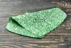 Scheibe des grünen Käses Lizenzfreie Stockfotografie