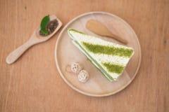 Scheibe des Kuchenkäsekuchens grünen Tees Matcha Stockbild