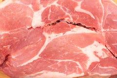 Scheibe des rohen Schweinefleischs Stockbilder