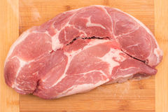 Scheibe des rohen Schweinefleischs Lizenzfreie Stockbilder