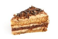 Scheibe des Sahnekuchens mit Schokolade lizenzfreies stockfoto
