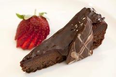 Scheibe des Schokoladenfondant-Kuchens Stockbild