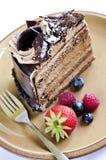 Scheibe des Schokoladenkuchens Stockfotos