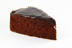 Scheibe des Schokoladensahnekuchens Lizenzfreies Stockfoto