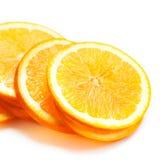Scheiben der frischen orange Frucht lokalisiert auf weißem Hintergrundabschluß Stockfoto