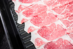 Scheiben des rohen Fleisches Stockbilder