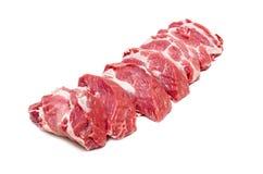 Scheiben des rohen Schweinefleischs Stockfotos
