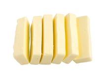 Scheiben von Butter lokalisiert Stockbild