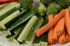 Scheiben von Gurken und von Karotten Stockbilder